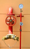 Water sprinkler and fire fighting system. On building wall Royalty Free Stock Photography