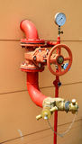 Water sprinkler and fire fighting system. On building wall Royalty Free Stock Images