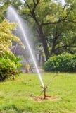 Water Sprinkler in public park Royalty Free Stock Image