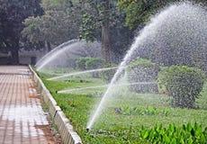 Water Sprinklers in Garden Royalty Free Stock Image