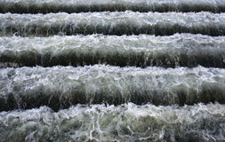 Water stairs. Rapid stream of water flowing in the bottom step Royalty Free Stock Images
