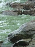 Water stands between large stones. Dnepr River. royalty free stock photo