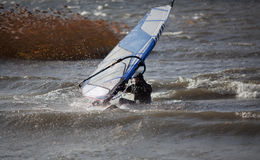 Water start. Wind surfing man while starting out of the water Stock Images