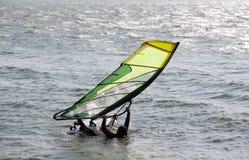 Water start. Windsurfer doing waterstart - starting out of water Royalty Free Stock Photo