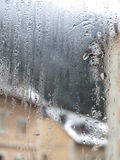 Water and Steam. Water reflection in a glass window in a winter day Stock Image