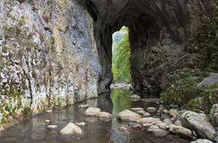 Water through stone tunnel Stock Images