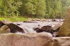 Water stones. Close up flowing water over stones in river Royalty Free Stock Photos
