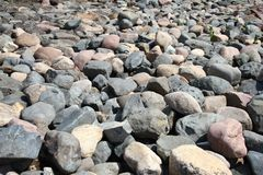 Water stones rocks pattern. Pebbles near water. Round stones background. Nature background. River bed and shore.  royalty free stock image