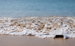 Water, stones and sand in the beach Royalty Free Stock Photos