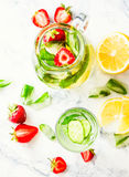 Water with strawberries, lemon, ice, mint. Detox. Royalty Free Stock Images