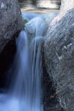 Water of a stream. Waterfall between rock in a river in mountains Stock Photos