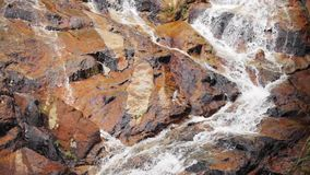 Water stream close up. Waterfall on stone mountain. Water stream close up in Thailand stock footage