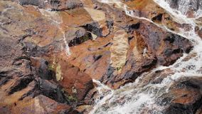 Water stream close up. Waterfall on stone mountain. Water stream close up in Thailand stock video