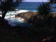 Water Stream Entering Pacific Ocean near Queen`s Bath in Princeville on Kauai Island, Hawaii. Stock Photo