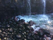 Water Stream Entering Pacific Ocean near Queen`s Bath in Princeville on Kauai Island, Hawaii. Stock Image
