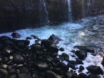 Water Stream Entering Pacific Ocean near Queen`s Bath in Princeville on Kauai Island, Hawaii. Royalty Free Stock Photos
