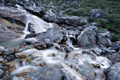 Water stream flowing among stones and rocks. Royalty Free Stock Photos