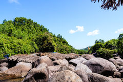 Water stream in high mountains. At the Lang Co town, Hue, Vietnam Royalty Free Stock Photography