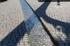 Water stream in pedestrian area. In south germany historical city, architecture, bank, blue, building, day, decoration, fountain, landscape, outdoor, pad, park stock photography