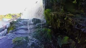 Water stream pounding against rocks, waterfall, slow motion. Stock footage stock footage