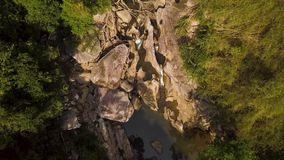 Water stream on rocky river and green forest aerial footage. Clear water in mountain river view from flying drone. Water stream on rocky river and green forest stock video footage