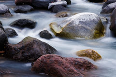 Water stream stones Stock Images