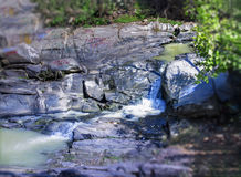Water stream between the Stones where lovers wrote Names. Royalty Free Stock Photography