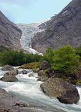 Water stream under a glacier. Picture was taken in Norway Stock Images