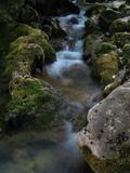 Water stream which goes among big stones. Water stream which goes among big stones Stock Images