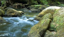 Water streaming. Serene picture of water streaming through the river royalty free stock photos