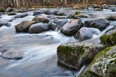 Big rocks in water. Water streaming between big rocks in river. Moss on rocks. Nice rapids scenery royalty free stock photography