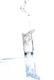 Water streaming from bottle isolated on white Royalty Free Stock Image