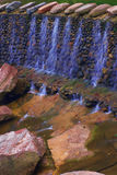 Water streams flowing Stock Images