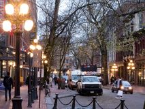 Water Street in historic Gastown in Vancouver at dusk. Colorful illumination gives a warm glow to cobblestone streets in the Gastown heritage district of stock images