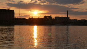 Water sunset beach. Ity night skyline with reflected in water stock video footage