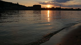 Water sunset beach. Ity night skyline with reflected in water stock footage