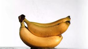 Water in super slow motion dripping on delicious bananas stock footage