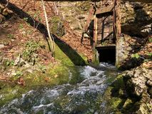 Water supply flowing source Tschuder with waterfall and karst spring or Karstquelle Tschuder, Schwende royalty free stock images