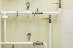 Water supply knot for the house. Water supply system. Distributing of pipes for hot and cold water supply of the house Royalty Free Stock Image