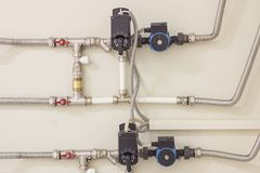 Water supply knot for the house. Water supply system. Distributing of pipes for hot and cold water supply of the house Stock Photo