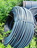 Water supply pipe in farmland Royalty Free Stock Images