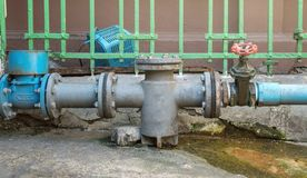 Water supply pipeline valves and faucets and are old and rusting. Near the deterioration and should maintenance and industry stock images