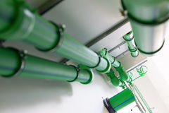 Water supply system. Green pipelines - water supply system Royalty Free Stock Image