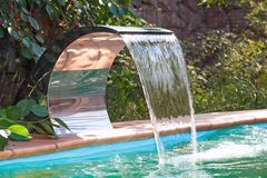Water supply to the pool by a waterfall. Royalty Free Stock Photo