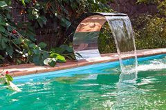 Water supply to the pool by a waterfall. Stock Photo