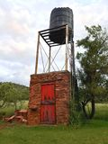 Water supply tower on farm royalty free stock photography