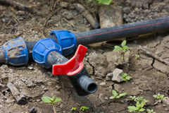 Water supply valve. In the ground of urban park Royalty Free Stock Photos