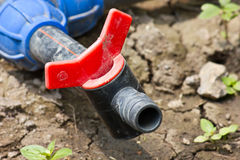 Water supply valve. In the ground of urban park Stock Photo