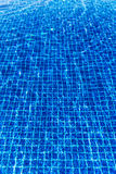 Water surface background in blue swimming pool Stock Images
