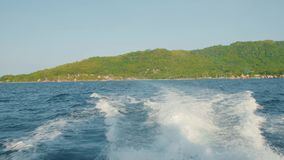 Water surface behind of fast moving motor boat, island Seychelles stock footage